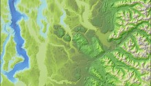 Lidar-derived hillshading with bathymetric and elevation color tints applied.